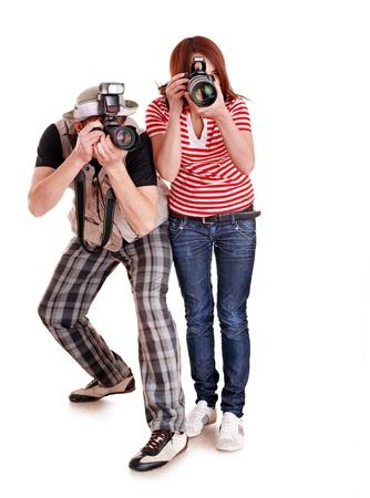 reporter: Photographe professionnel avec appareil photo num�rique. Isol�.