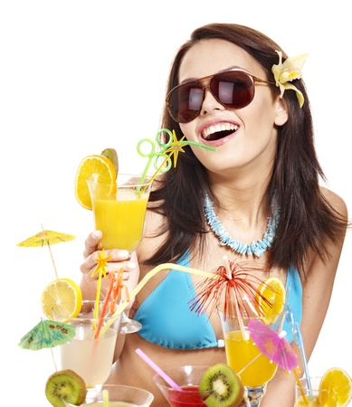 Girl in bikini on beach drinking cocktail. Isolated. photo