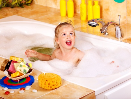 Child washing in bubble bath . Stock Photo - 12752329