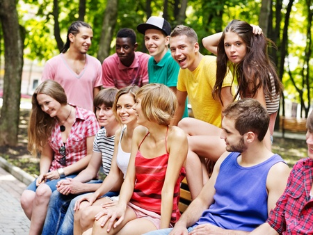 group of people: Multi-ethnic group of people outdoors.