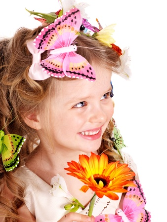 Little girl in spring hairstyle and butterfly. Isolated. photo