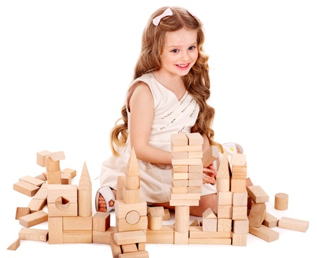 Happy child play building blocks. Isolated. photo