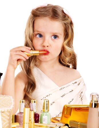 girl in dress: Child cosmetics. Little girl with lipstick. Isolated.