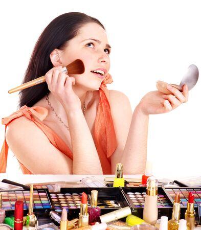 Girl applying makeup. Isolated. photo