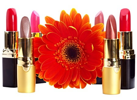 Lipstick group and flower. Decorative cosmetics. Isolated. Stock Photo