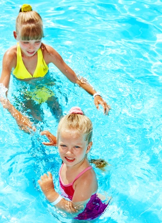 Children with armbands in swimming pool. Stock Photo
