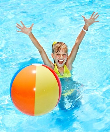 kids playing water: Little girl  swimming in pool. Stock Photo