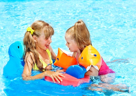 armbands: Child with armbands in swimming pool.