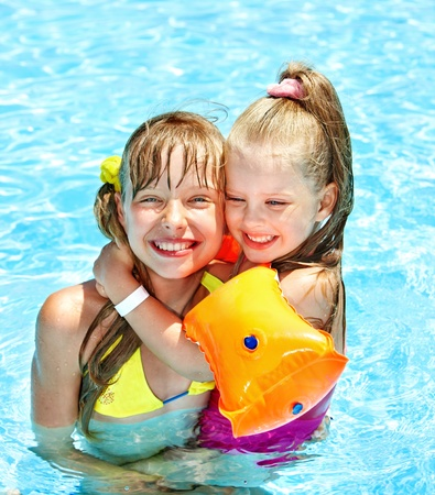 armbands: Children with armbands in swimming pool.