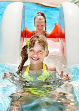 Children on water slide at aquapark. Summer holiday. Stock Photo - 13258369