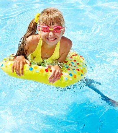 Little girl in swimming pool. Summer outdoor. Stock Photo - 13258960