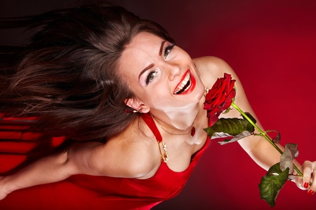 Young woman with red rose flower. Valentines day. photo