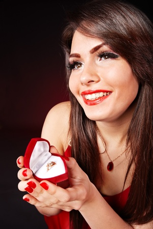 Girl holding jewellery gift box.  Valentines day. photo