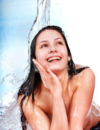 moisten: Beautiful  girl in water. Body care. Isolated. Stock Photo