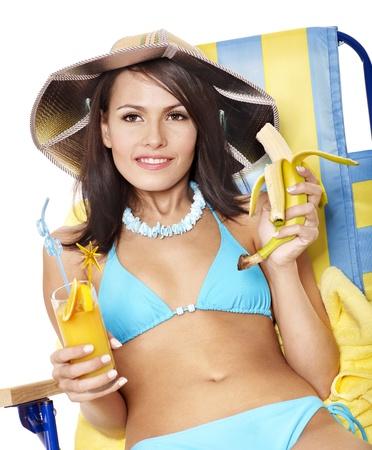 Girl in bikini drink juice through a straw. Isolated. photo