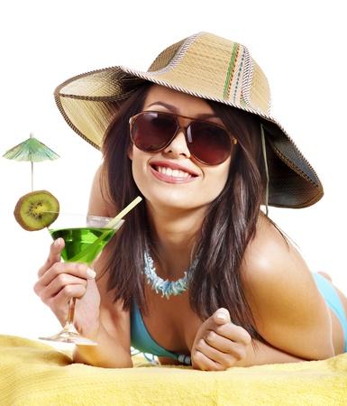 Young woman in bikini drink juice through straw. Isolated. photo