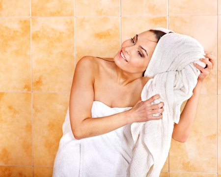woman in towel: Young woman take bubble  bath.