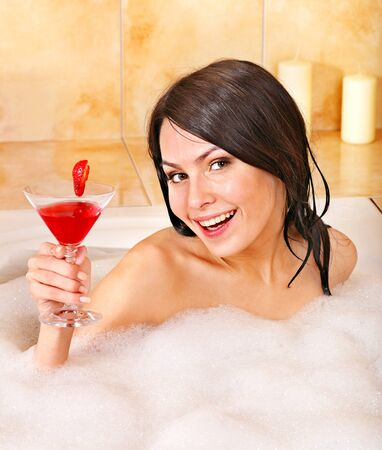 Young woman washing in bubble bath. Stock Photo - 13259108
