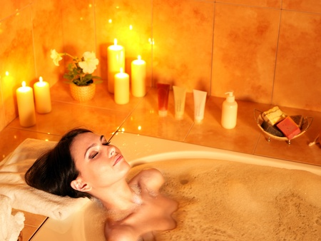 bathtub: Young woman take bubble  bath.