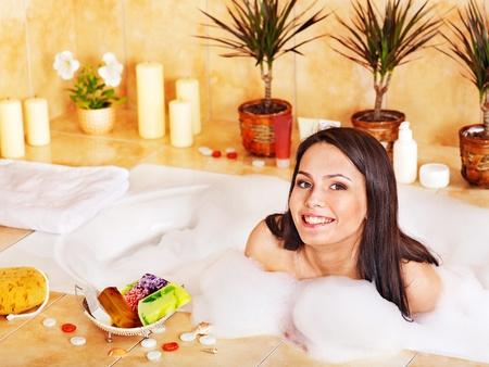 relaxion: Young woman take bubble  bath.