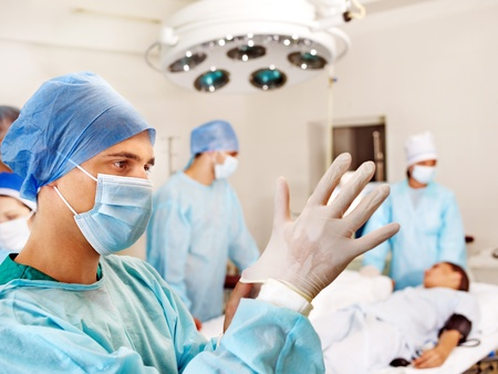 Sick patient on gurney in operating room. Stock Photo - 13259002