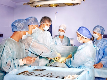 operating theater: Sick patient on gurney in operating room.