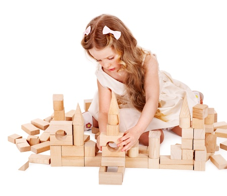 Happy child playing building blocks. Isolated. photo
