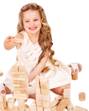 play blocks: Happy child playing building blocks. Isolated.