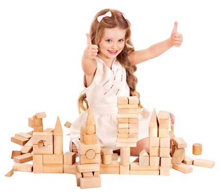 upbringing: Happy child playing building blocks. Isolated.