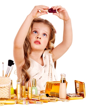 Child cosmetics  Little girl applying make up  photo
