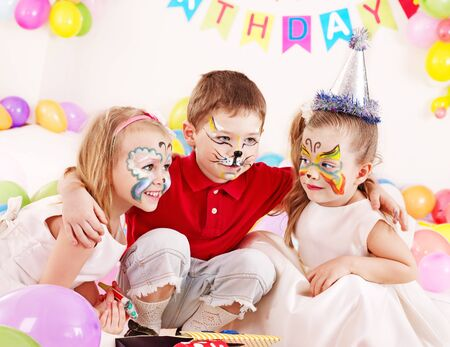 painting face: Children happy birthday party . Stock Photo