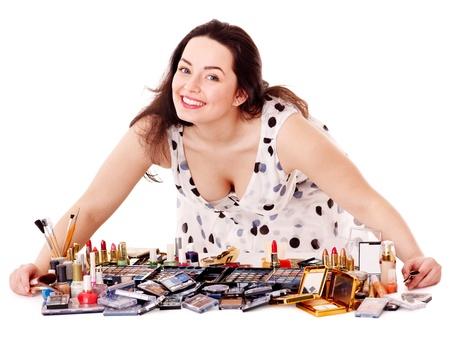 Girl applying makeup. Isolated. Stock Photo - 13258619