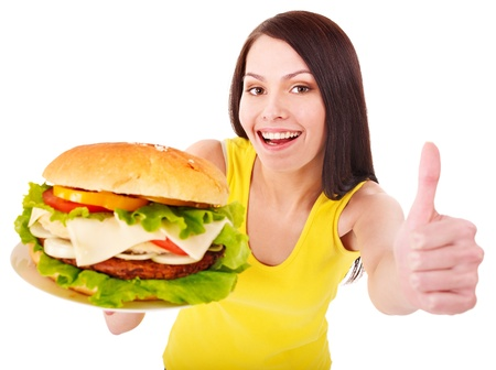 adult sandwich: Woman holding hamburger. Isolated. Stock Photo