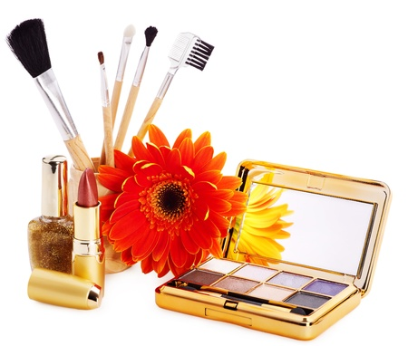 Decorative cosmetics and flower. photo