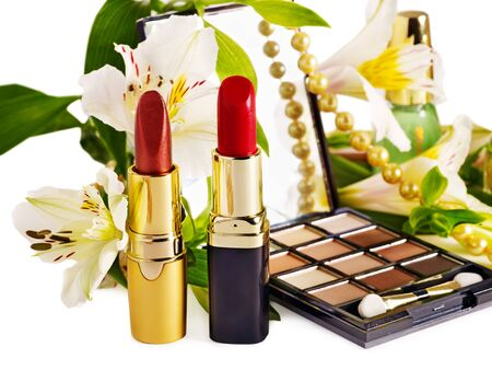 Decorative cosmetics and flower. Isolated. photo