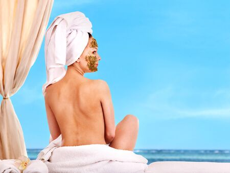 Young woman getting spa treatment outdoor. photo