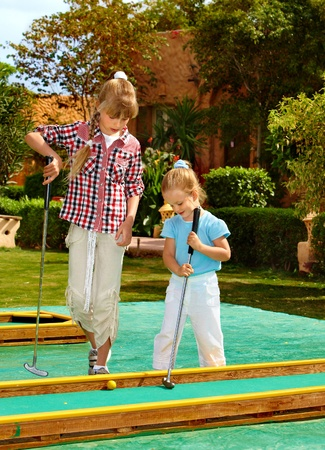 children playing together: Children playing in golf. Outdoor. Stock Photo