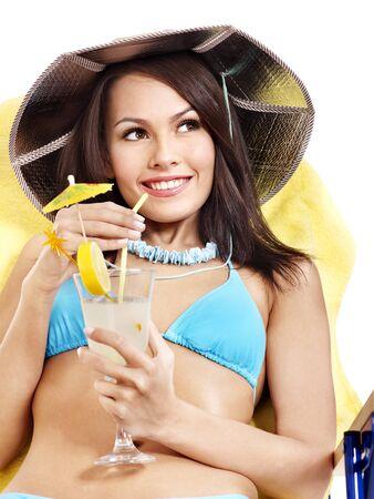 Girl in bikini drink juice through  straw. Isolated. photo