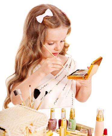 Child cosmetics. Little girl applying make up. Stock Photo - 13308327