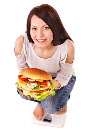 Woman weight loss on scales. Isolated. Stock Photo - 13309662