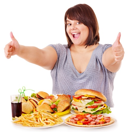 Overweight woman eating fast food. Stock Photo - 13309934