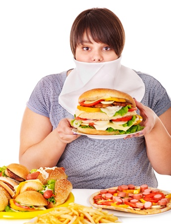 Overweight woman refusing fast food. photo