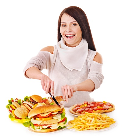 Woman eating fast food. Isolated. Stock Photo - 13309578