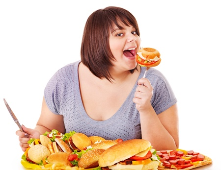 Woman eating fast food. Isolated. Stock Photo - 13309617