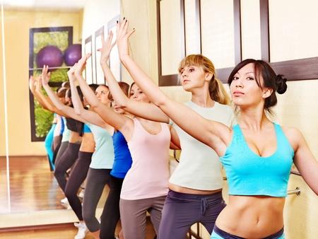 barre: Women group in aerobics class.