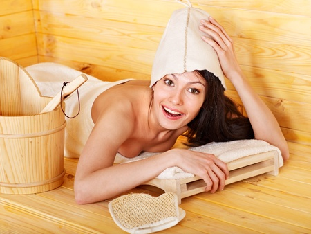 Young woman in sauna. Stock Photo - 13308344