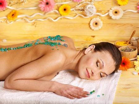 Woman getting  massage body salt scrub. photo