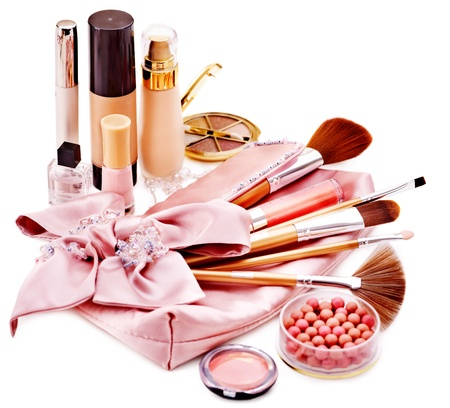 feminine beauty: Decorative cosmetics and flower. Isolated.