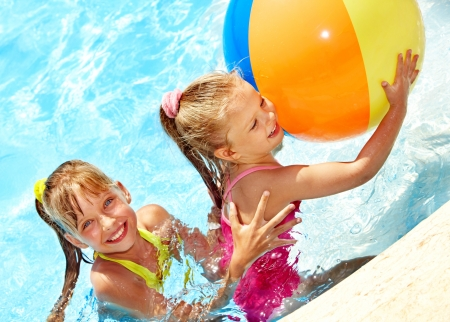 ball aqua: Children playing with ball in swimming  pool. Stock Photo