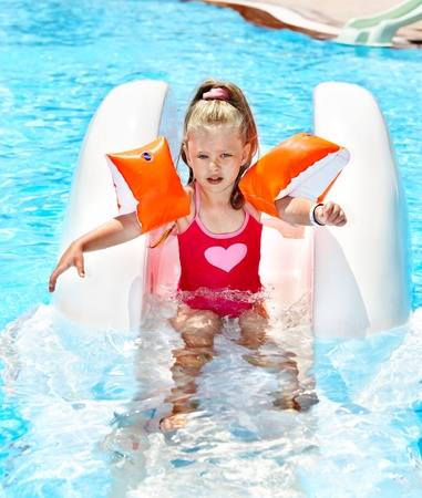 Child on water slide at aquapark. Summer outdoor. Stock Photo - 13563209